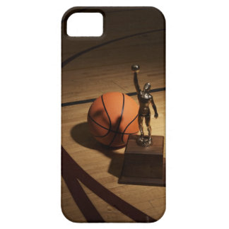 Basketball and trophy on basketball court, iPhone 5 cover