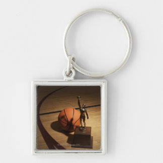 Basketball and trophy on basketball court, key ring