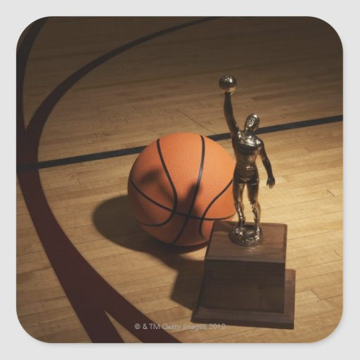 Basketball and trophy on basketball court, square stickers