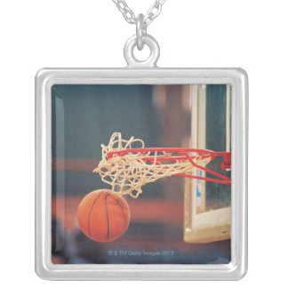 Basketball dropping through hoop silver plated necklace