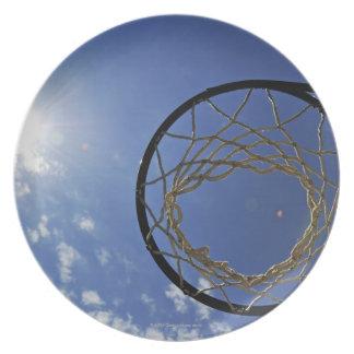 Basketball Hoop and the Sun, against blue sky Plate