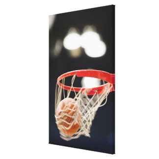 Basketball in basket. canvas print