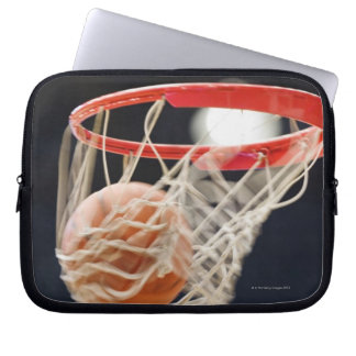 Basketball in basket. laptop computer sleeves