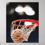 Basketball in basket. poster