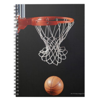 Basketball in hoop, close-up 2 notebooks