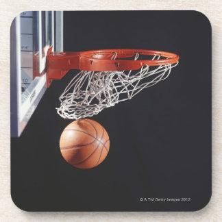 Basketball in hoop, close-up coaster