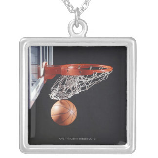 Basketball in hoop, close-up silver plated necklace