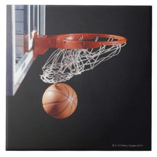Basketball in hoop, close-up tile