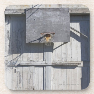 Basketball net on rustic building coaster