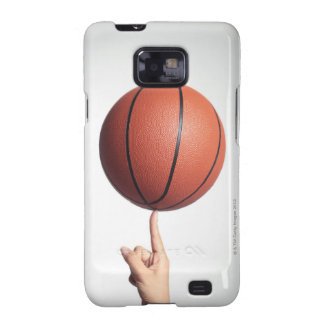 Basketball on index finger,hands close-up samsung galaxy covers