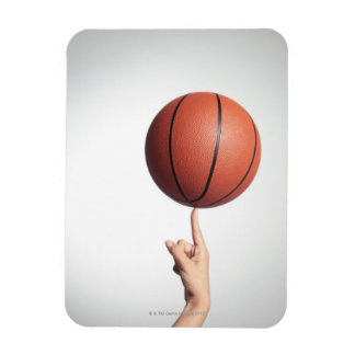Basketball on index finger,hands close-up magnet
