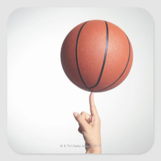 Basketball on index finger,hands close-up square sticker