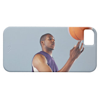 Basketball player balancing ball on one finger iPhone 5 cases