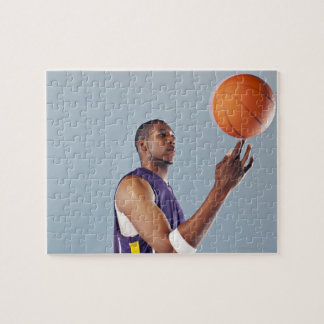Basketball player balancing ball on one finger jigsaw puzzle