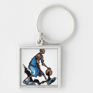 Basketball player dribbling ball keychain