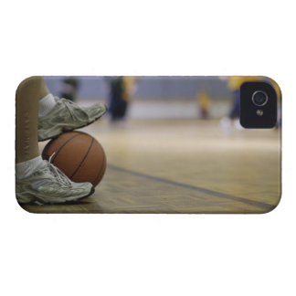 Basketball player holding ball with feet iPhone 4 case