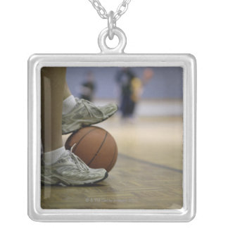 Basketball player holding ball with feet silver plated necklace