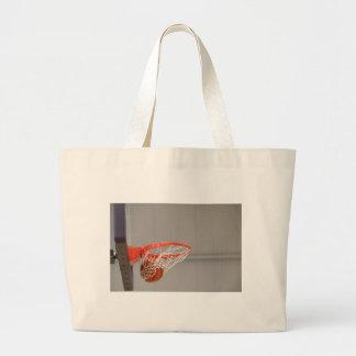 Basketball Swishing Through The Net Tote Bags