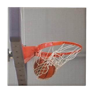 Basketball Swishing Through The Net Ceramic Tile