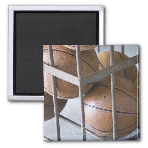 Basketballs in a basket refrigerator magnets
