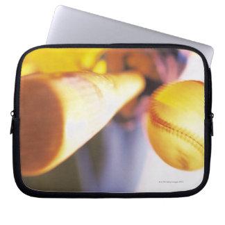 Bat contacting baseball laptop sleeve