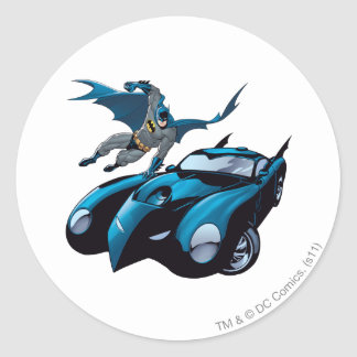 Batman swings over round stickers