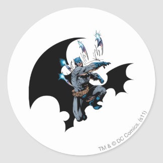 Batman throws weapons classic round sticker