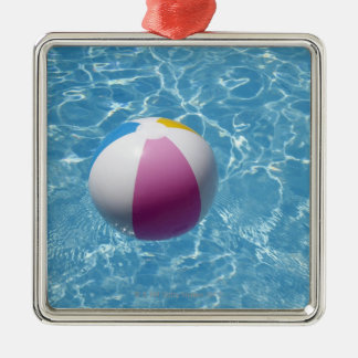 Beach ball in swimming pool christmas ornament