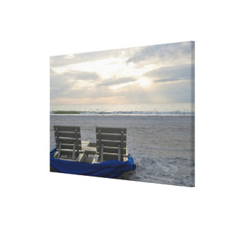 Beach chairs on St. Pete's beach at sunset. Canvas Print