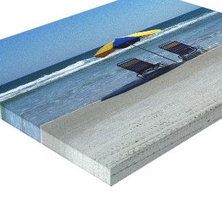 Beach Chairs on The Shoreline Canvas Print