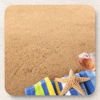 Beach corner border with towel, starfish and drink coasters