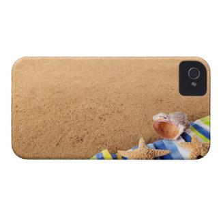 Beach corner border with towel, starfish and iPhone 4 case