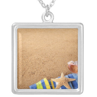 Beach corner border with towel, starfish and silver plated necklace