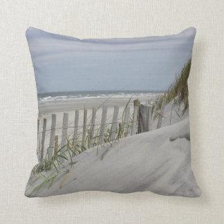Beach fence and sand dune at the beach cushion