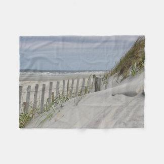 Beach fence and sand dune at the beach fleece blanket