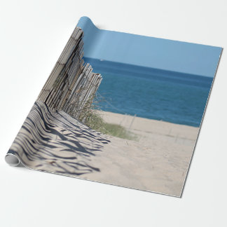 Beach fence casting shadows in the sand wrapping paper
