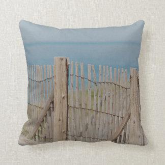 Beach fence in the sand dune cushion