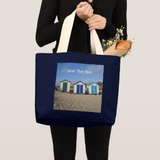 Beach huts blue skies sand english seaside photo large tote bag