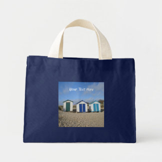 Beach huts blue skies sand english seaside photo mini tote bag