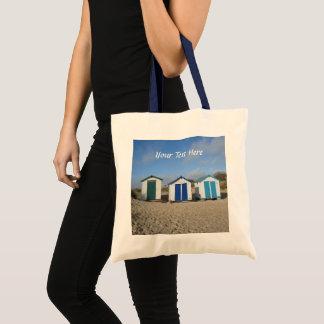 Beach huts blue skies sand english seaside photo tote bag