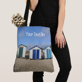 Beach huts blue skies sand english seaside photo tote bag