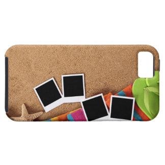 Beach scene with blank photo prints, towel, iPhone 5 cases