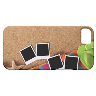 Beach scene with blank photo prints, towel, iPhone 5 cover