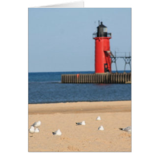 Beach scene with seagulls and lighthouse greeting card