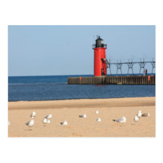 Beach scene with seagulls and lighthouse postcard