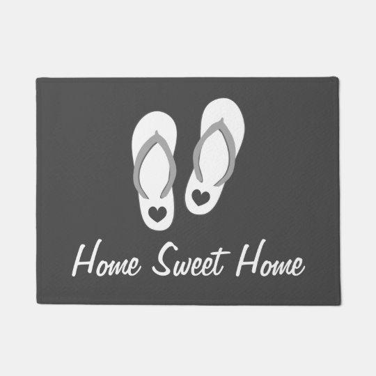 Beach theme door mat with flip flops and