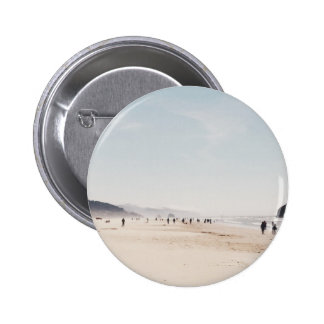 Beach with people during a summer afternoon 6 cm round badge