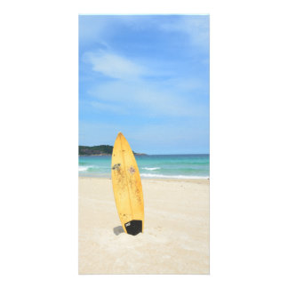 Beach with yellow surf board photo card