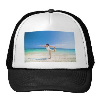 beach yoga performed by a matured asian female mesh hats