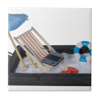 BeachChairUmbrellaLaptopSand011815.png Tile